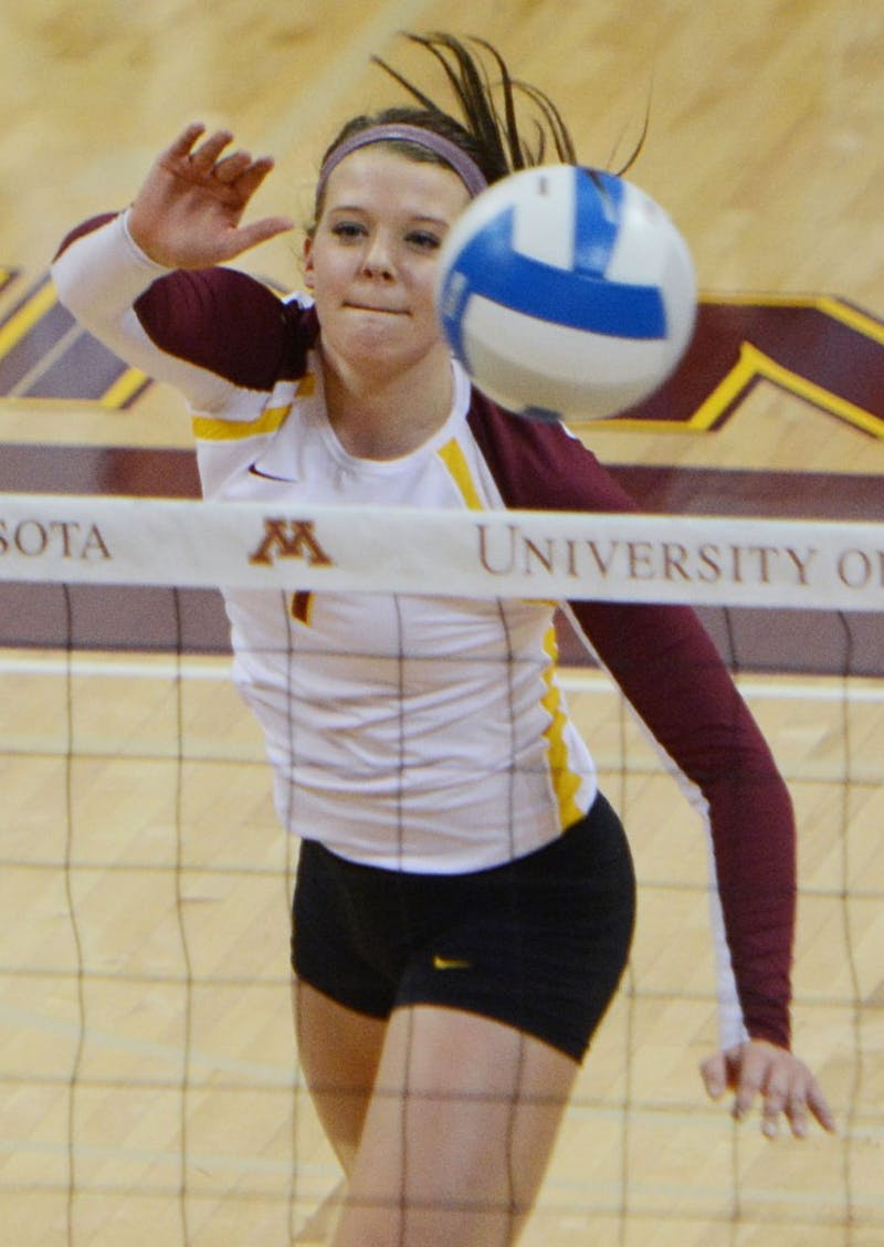 Minnesota middle blocker Hannah Tapp hit a ball over the net against Purdue on Sept. 28, 2013, at the Sports Pavilion.