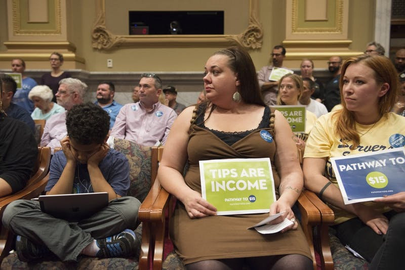Sarah Webstor Norton waits to be called to speak during a public hearing at Minneapolis City Hall on Thursday, June 22. Sarah works in the service industry and is in favor of a proposed $15 minimum ordinance.