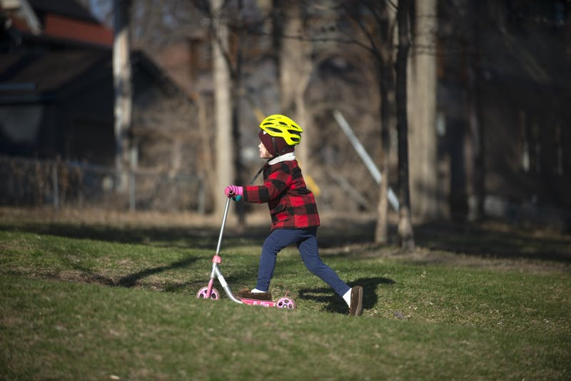 Sullivan Moran (4) rides his scooter uphill at Powderhorn park in Minneapolis on Tuesday, March 31.