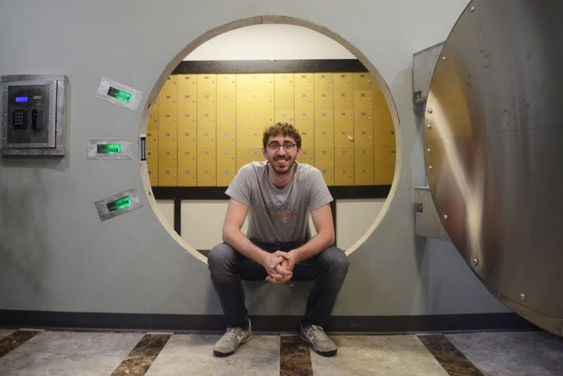Mechanical engineering student Kenny Hubbell poses in an escape room he constructed at Puzzleworks on Wednesday, April 12, 2017 in St. Paul.