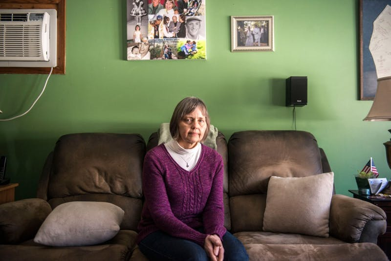 Mariana Schunk sits in the livingroom of her family's Burnsville home, Saturday, March 8. A collage of their family made my Anarae hangs above her head along with other family photos.