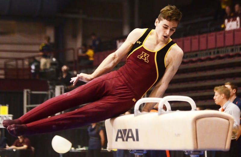 Minnesota gymnast Ellis Mannon competes on the pommel horse Friday, April 5, 2013, at the Sports Pavilion.