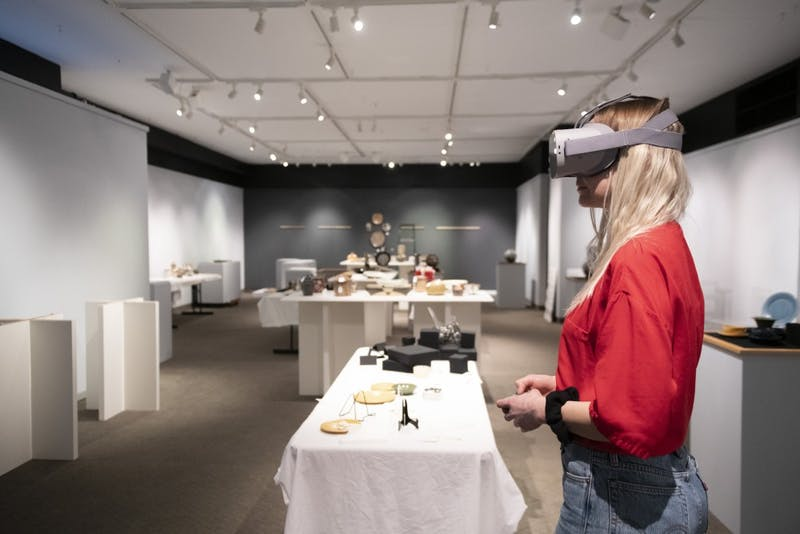 Crystal Compton, a wearable technology Ph.D. student,  demonstrates a virtual reality headset at the Goldstein Museum of Design in Saint Paul on Friday, Jan. 18. The museum is bringing the exhibits outside their walls by making virtual exhibits available to communities who may not be able to visit the site in person.