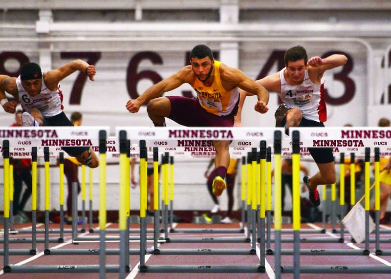 Luca Wieland competes in the men's hurdles at the Fieldhouse for the second annual Minnesota-Wisconsin Dual on Jan. 23.