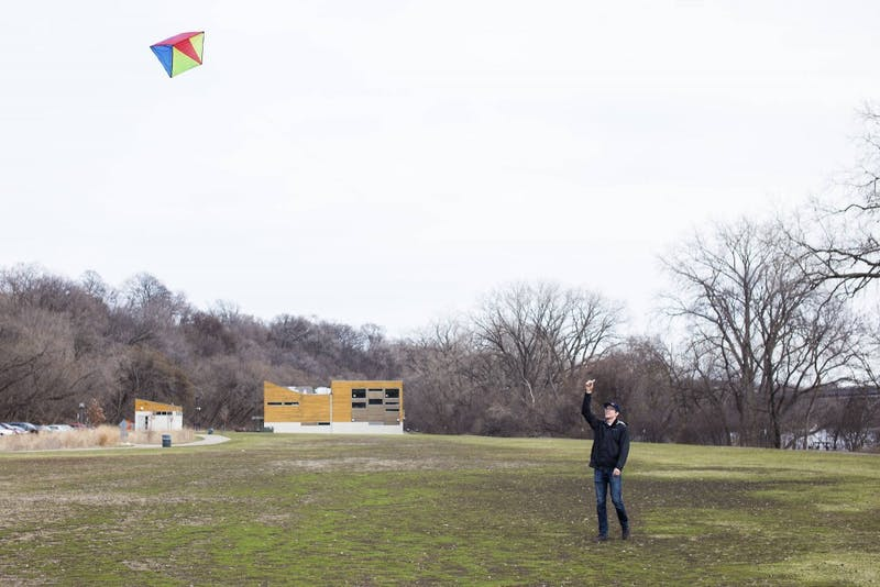 Taking advantage of the strong winds, sophomore Jack Lange flies his kite by the Mississippi on the East River Flats.
