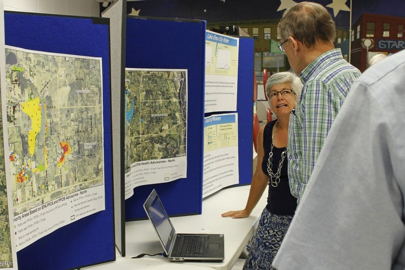 Hydrogeologist for the Minnesota Department of Health Virginia Yingling explains data on local water to visitors at a public meeting at Oakland Middle School on Sept. 19 2016.