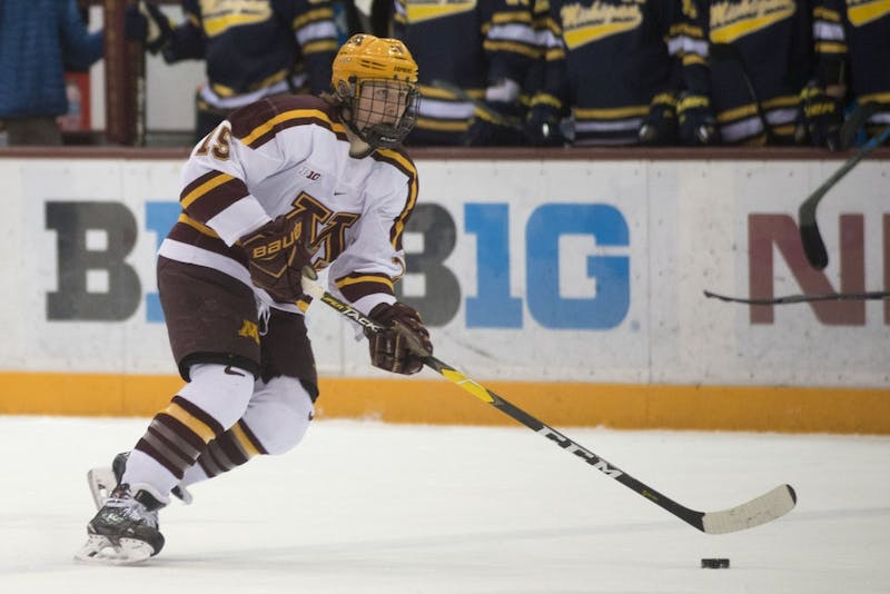 Junior Rem Pitlick skates with the puck on Friday, March 8 at Mariucci Arena in Minneapolis.