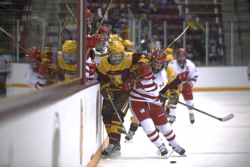 Forward Taylor Williamson battles with Badgers defender Melissa Channell for the puck during the WCHA Final Faceoff at Ridder Arena on March 6, 2016.
