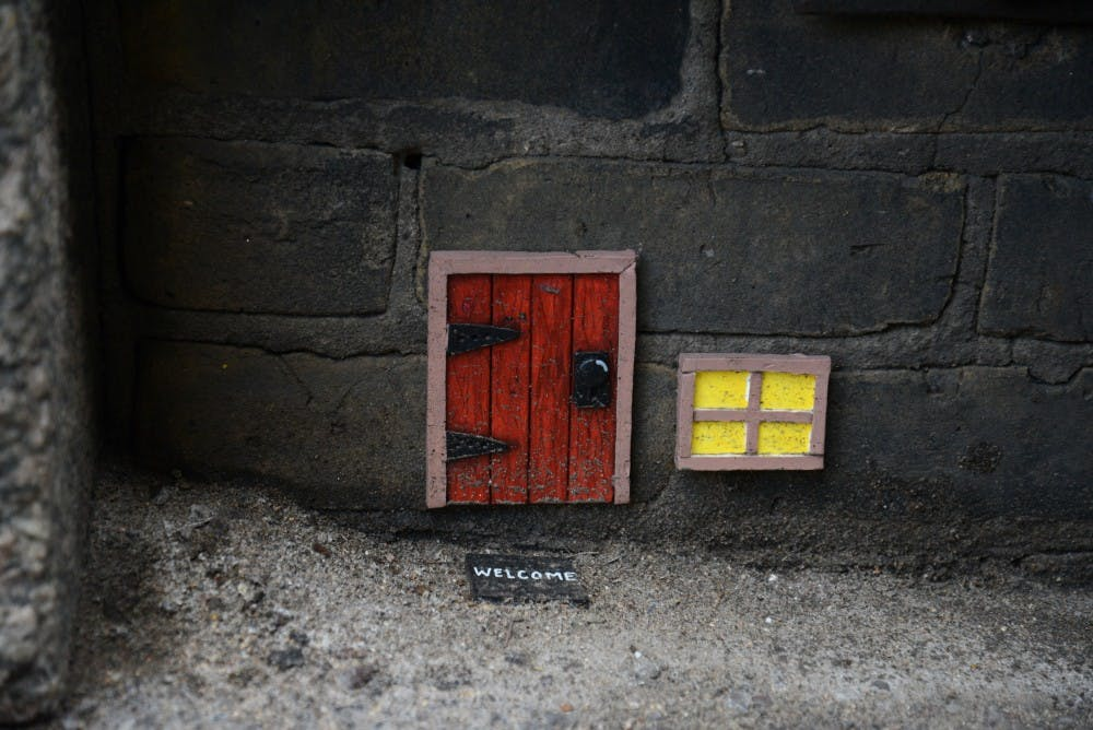 Local street artist decorates Twin Cities with little 'mouse' doors