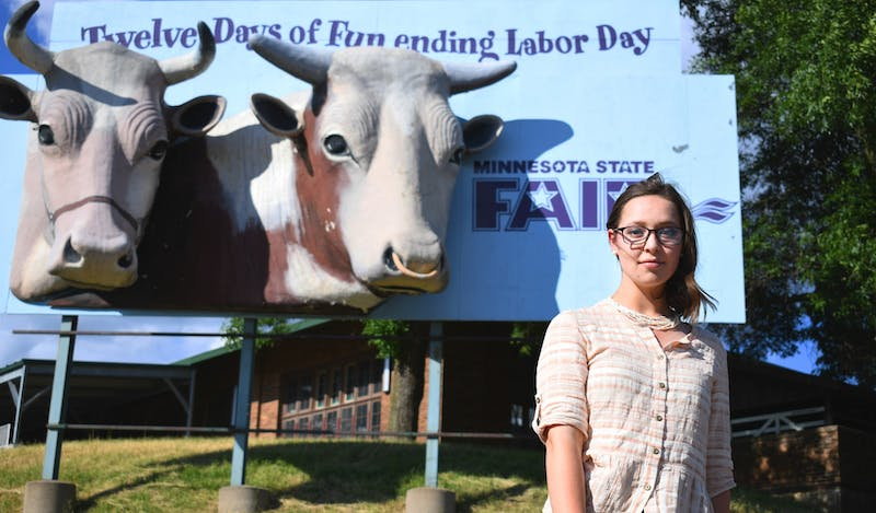 Agriculture communication major Elaine Dorn in the Minnesota State Fairgrounds on Wednesday, June 24. Dorn was planning to show her sheep at this year's fair before it was canceled due to Covid-19.