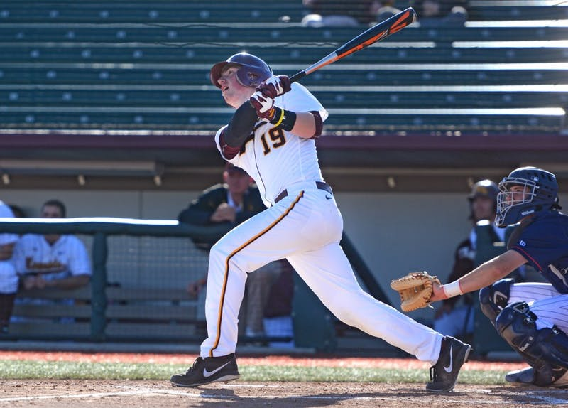 Gophers centerfielder Austin Athmann swings at a pitch at Siebert Field on Mar. 31, 2015.