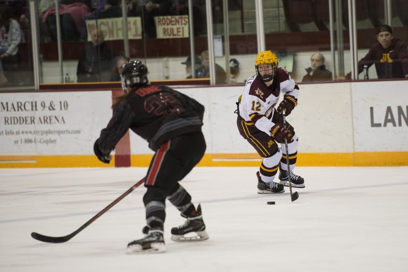 Sophomore forward Grace Zumwinkle eyes her opponent at Ridder Arena on Friday, Oct. 19. The Gophers beat Ohio State 3-0.