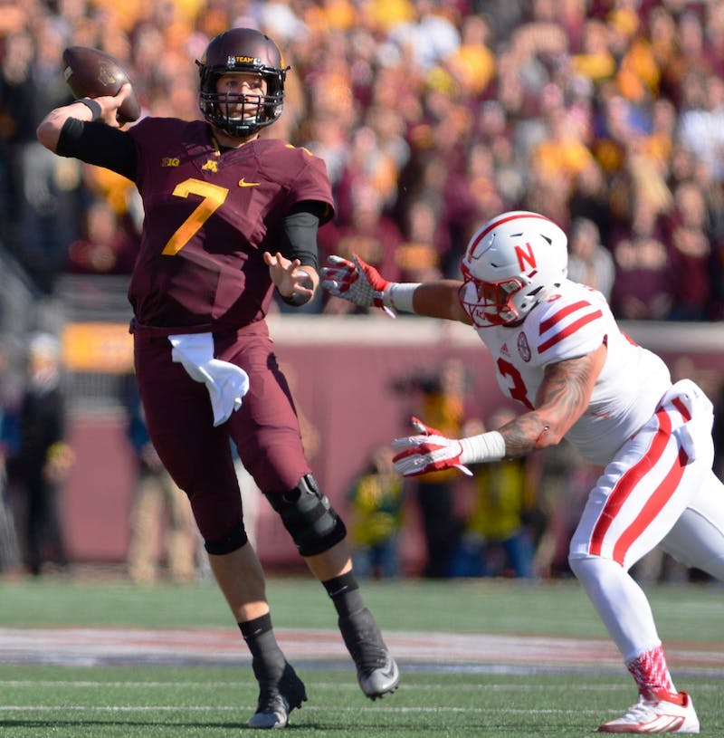 Quarterback Mitch Leidner throws a pass to make Gopher's first touchdown of the game at TCF Bank Stadium Saturday where Minnesota fell to the Nebraska Cornhuskers 48-25.