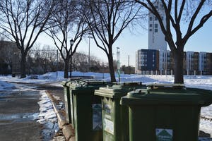 Community use organics drop-off bins are seen at Van Cleve Park on Friday, Feb. 21.