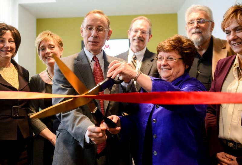 Dean of the Medical School Brooks Jackson, left, and Dean of the School of Nursing Connie White Delaney, prepare to cut the ribbon at the Nurse Practitioners Clinic Tuesday evening. The new nurse-led clinic will officially open April 6.