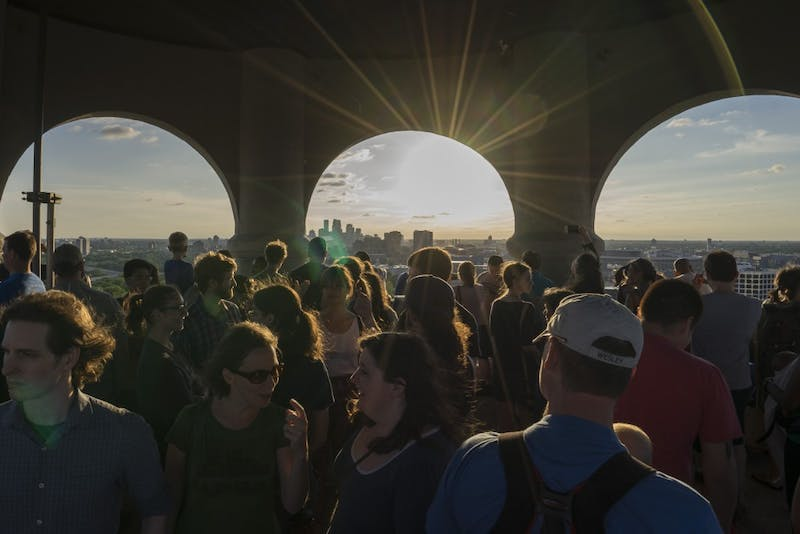 Visitors celebrate at the top of Witch's Hat Tower on Saturday, June 1. Built in 1913, Witch's Hat Tower has been a major landmark in Minneapolis for generations. New developments have been proposed near Prospect Park, and the Prospect Park Association is concerned that the height of developments will block the view from the tower.