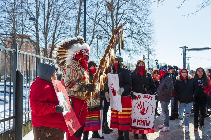 Demonstrators stand the Minneapolis American Indian Center before the march. The event was held to honor missing and murdered Indigenous women and to raise awareness of other issues in the community.