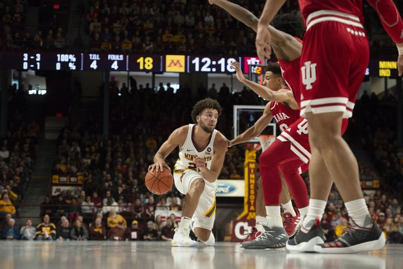 Freshman Gabe Kalscheur dribbles past Indiana University players on Saturday, Feb. 16 at Williams Arena. The Gophers won 84-63.