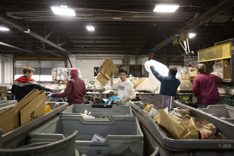 Employees sort waste into different recycling categories at the Como Recycling Facility on Friday, Jan. 18 in Minneapolis.