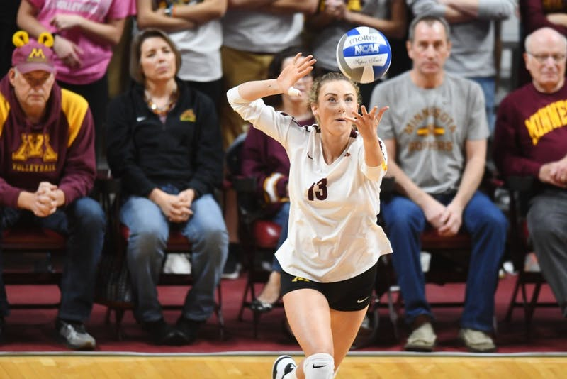 Senior Samantha Seliger-Swenson serves the ball on Friday, Oct. 19 at Maturi Pavilion.