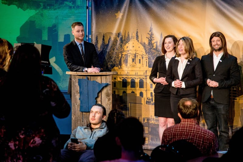 Jonathan Gershberg, host of Minnesota Tonight, delivers a monologue encouraging Michele Bachmann to run for Al Franken's recently-opened seat, during the show's season 3 premier, Wednesday Jan. 24. The group to his right insist that only God can decide if Bachmann runs for the seat.