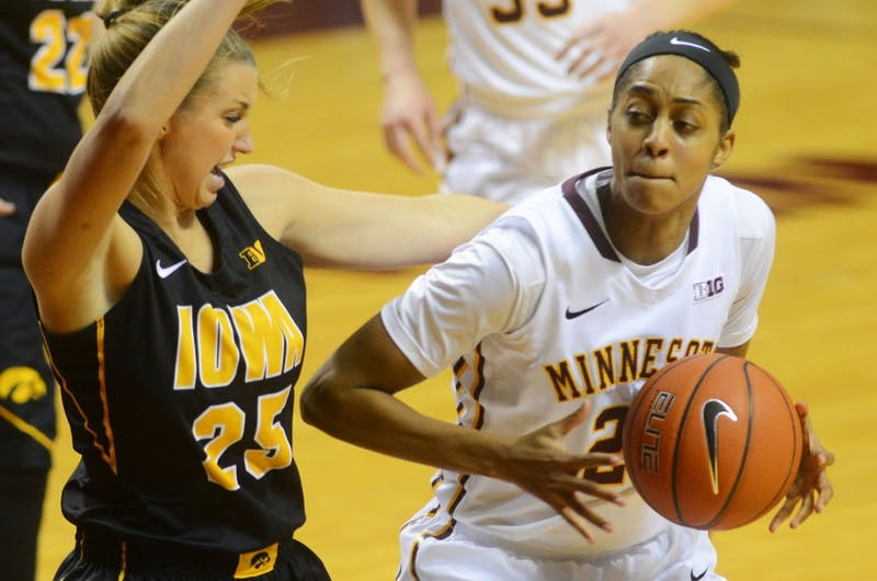 Forward Shae Kelley holds on to the ball against the Hawkeyes on Feb 17 at Williams Arena.
