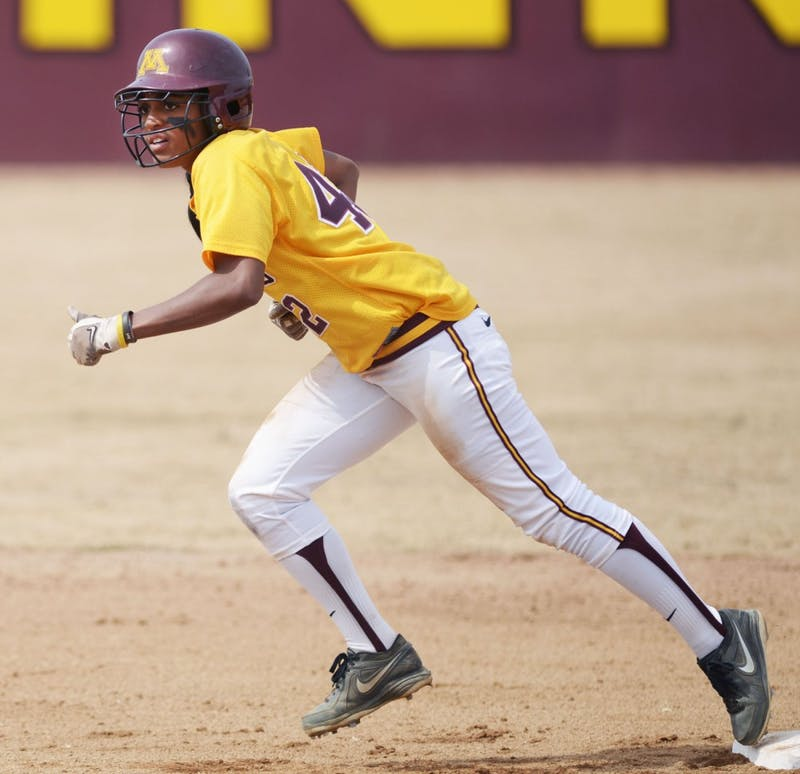 Minnesota infielder Tyler Walker attempts to steal a base against Wisconsin on April 7, 2013, at Jane Sage Cowles Stadium.
