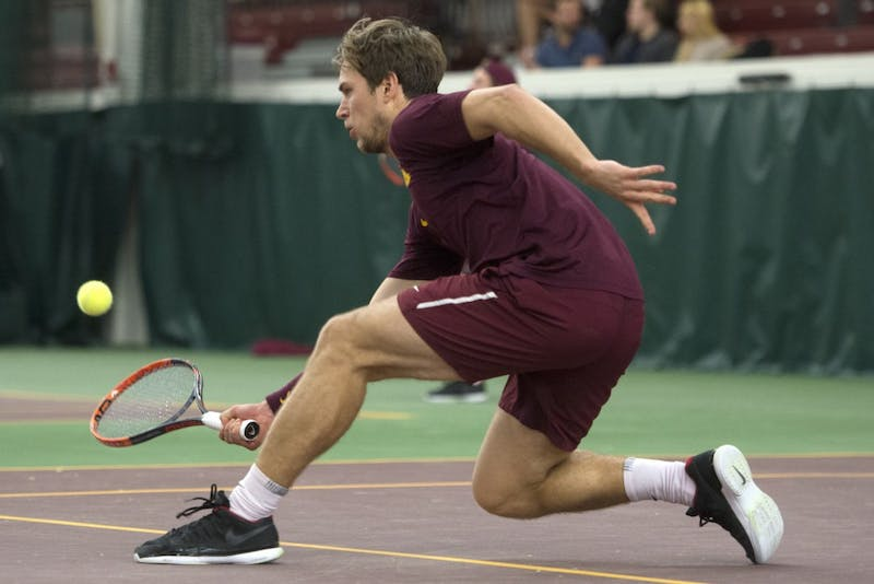 Senior Matic Spec returns the ball during his singles match against the University of Pennsylvania at the Baseline Tennis Center on Sunday, Feb. 25.
