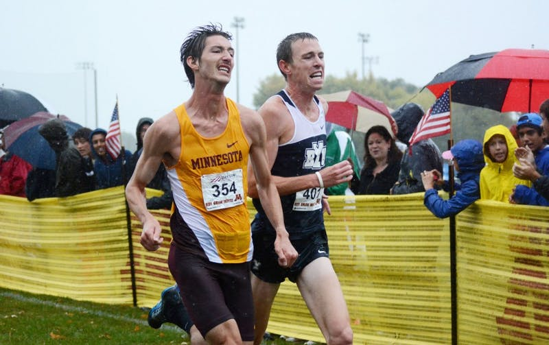 Minnesota senior John Simons outruns Brigham Young's Jason Witt at the finish of the men's Division I Roy Griak Invitational on Saturday, Sept. 28, 2013, at Les Bolstad Golf Course.
