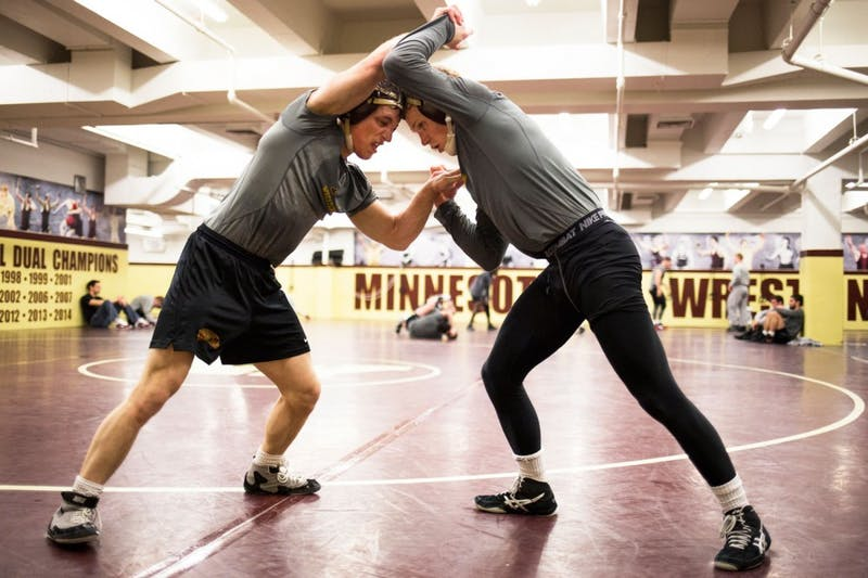 "During a post-practice sparring match, redshirt freshman Skyler Petry and junior Sam Brancale wrestle ""live"" to emulate a real competition setting while withholding their full effort."