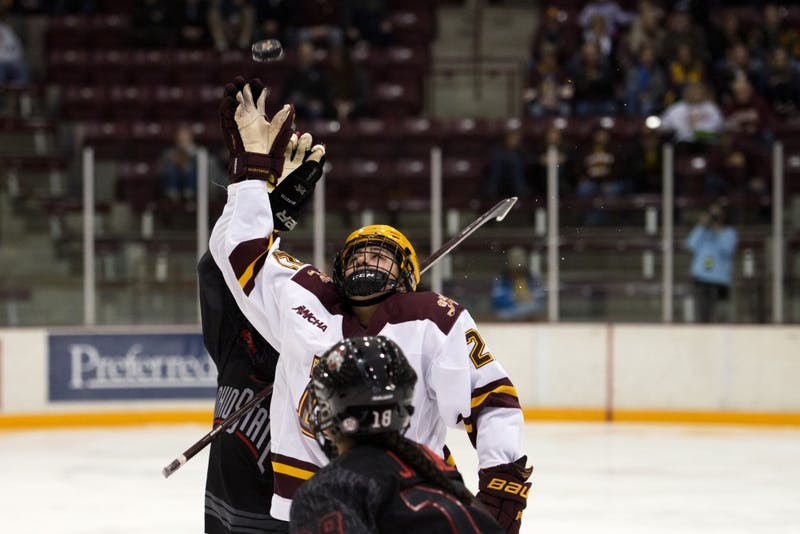Forward Emily Oden reaches up to grab the puck at Ridder Arena on Friday, Oct. 19.