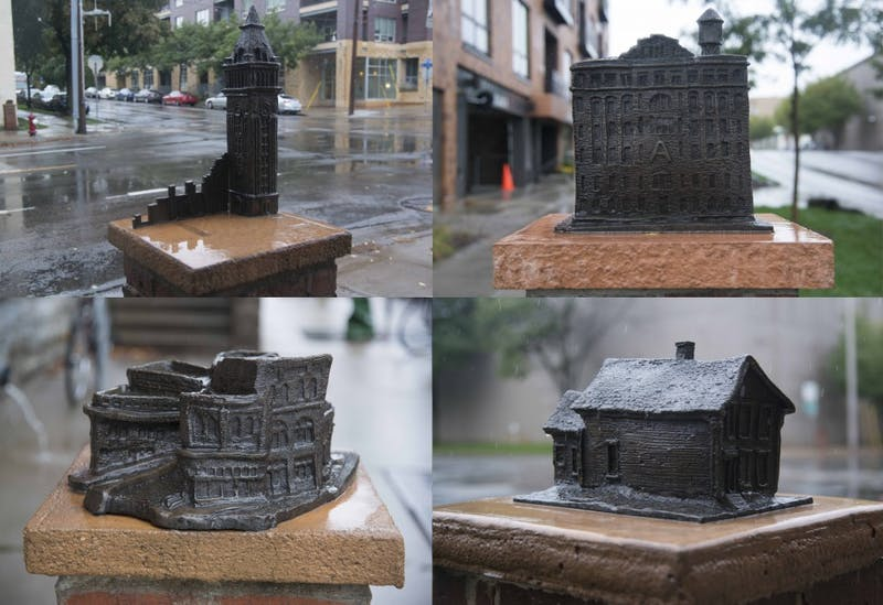 Examples of some of the work featured on the Creative Spark website. Aldo Moroni created bronze sculptures of many historical structures and sites in the Marcy-Holmes neighborhood, which stand near the Stone Arch Bridge on Sunday, Oct. 1.