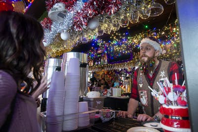 A bartender serves customers at Betty Danger's Country Club in Northeast Minneapolis on Saturday, Dec. 7. The club held its fourth annual Betty's Bizarre Bazaar which is an event for local artists to sell their art and homemade food supplies.