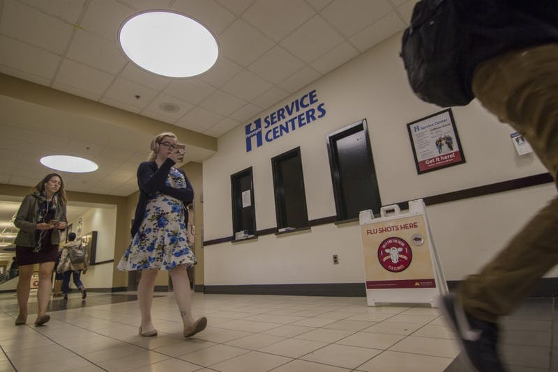 Students walk past the Hennepin County Commissioner's Office in Coffman Memorial Union on Tuesday, Sept. 17. The office, which resources like license plate registration, is open one day per week.