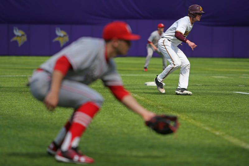 Catcher Eli Wilson makes his way to third base during the game against St. John's University on Saturday, March 31, 2018 at U.S. Bank Stadium.