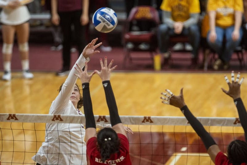 Middle Blocker Regan Pittman jumps to spike the ball at the Matrui Pavilion on Saturday, Oct. 5. The Gophers defeated Rutgers three sets to one.