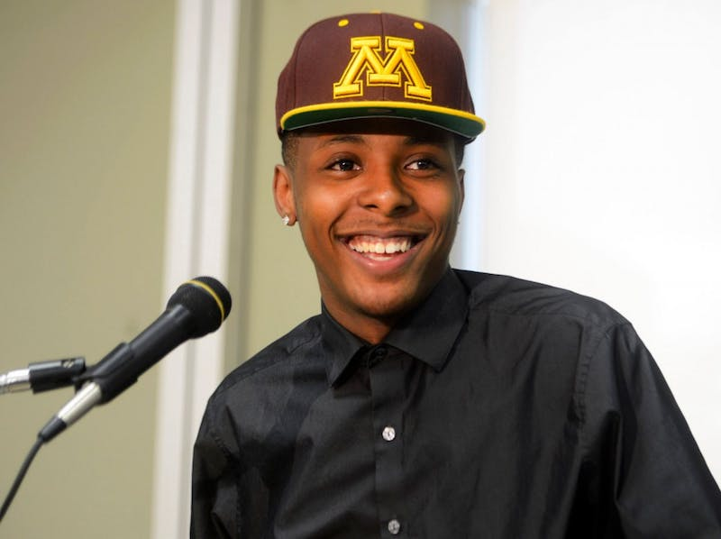 DeLaSalle High School senior Jarvis Johnson announces his commitment to play basketball for Minnesota on Sept. 12, 2014  at DeLaSalle.