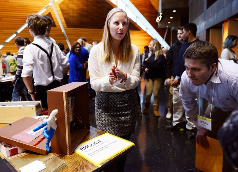 "Mechanical engineering student Kelsey Harper presents RHONDA, a robotic hand capable of playing ""Rock, Paper, Scissors"" to judge Jesse Geroy during the annual Mechanical Engineering Robot Show in the McNamara Alumni Center on Monday afternoon."