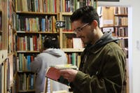 """Alex Pieczynski and Kathy Patino browse the shelves of The Book House on Thursday, May 2. Pieczynski and Patino are members of Chicago band """"GIRL K."""""""
