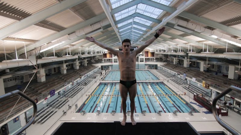 Jeremy Moser balances himself on the edge of the 10 meter platform before diving off during practice on Friday, Feb. 15 at the Jean K. Freeman Aquatic Center.