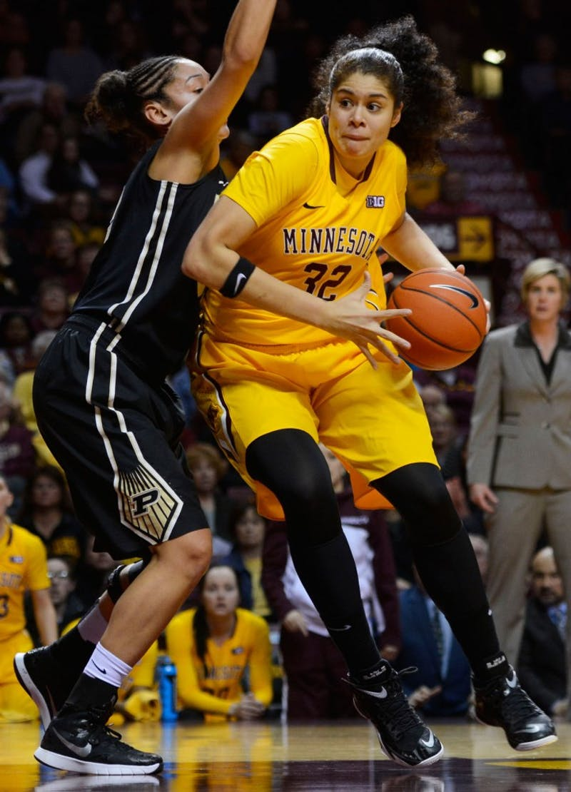 Gophers guard Amanda Zahui B. runs the ball past Purdue at Williams Arena on Thursday. Purdue beat out Minnesota by 2 points in overtime, with a final score of 90-88.