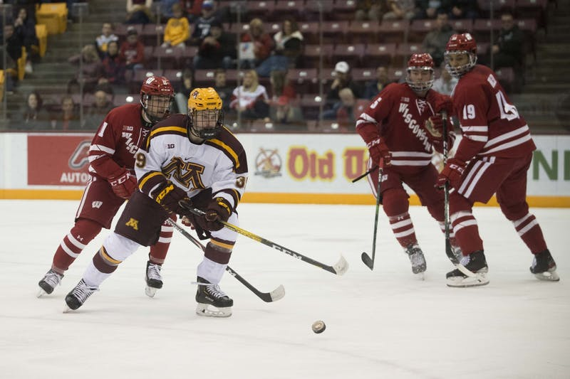 Forward Sammy Walker looks to control the puck during the game against the Wisconsin Badgers at 3M Arena at Mariucci on Friday, Nov. 22. The Gophers won 4-1.