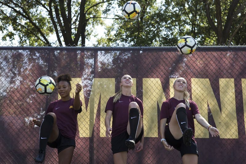 Freshman forwards Patricia Ward, left, McKenna Buisman and Megan Gray knee the ball for a portrait on Wednesday, Sept. 12 at Elizabeth Lyle Robbie Stadium in Saint Paul. The three freshman have played in all seven matches so far this season.