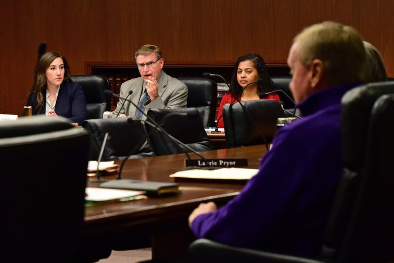 Minnesota House of Representatives Committee on Higher Education Chair Bud Nornes speaks to Rep. Gene Pelowski during the committee's hearing on the University's Board of Regents selection process at the Minnesota State Office Building on Feb. 28, 2018.