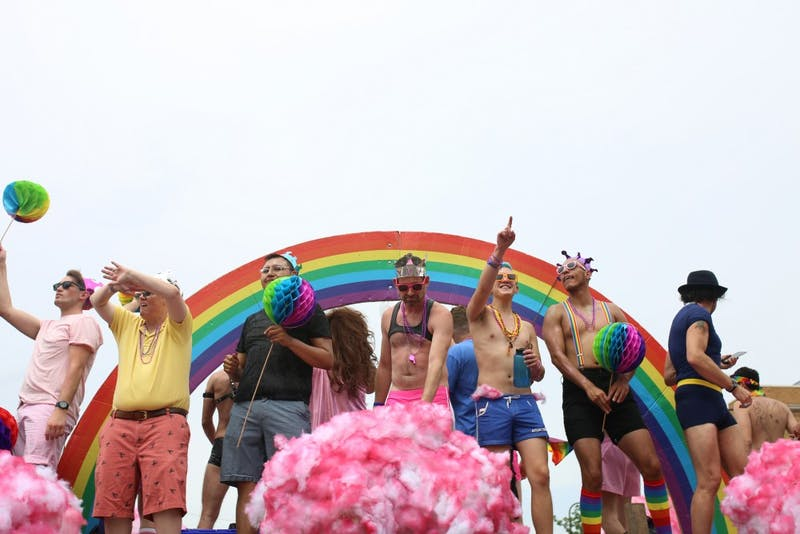 A pride float progresses down the parade route.