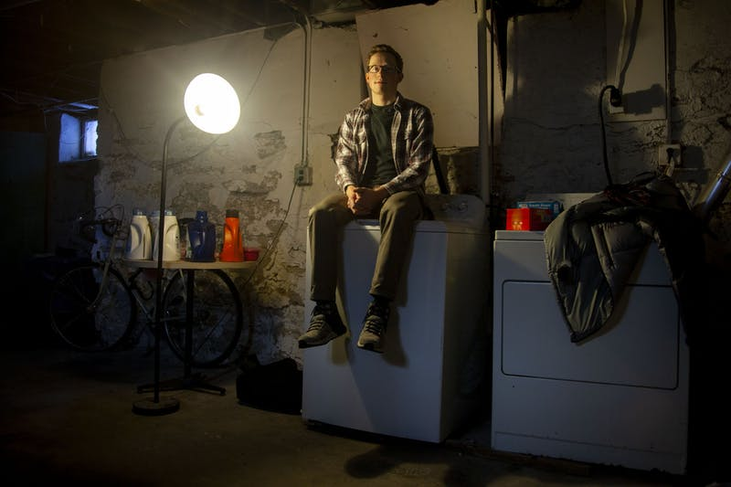 Senior Garrett Williams poses for a portrait in the basement of his former residence in the Marcy Holmes neighborhood on Saturday, Feb. 8.  The Miles Group owned property suffered from hazardous heating equipment, a partially collapsed ceiling and an overall lack of maintenance.