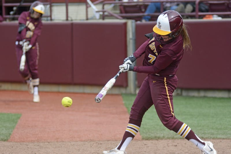 Gophers senior Sam Macken hits the ball against Purdue at Jane Sage Cowles Stadium on Saturday, April 30, 2017.