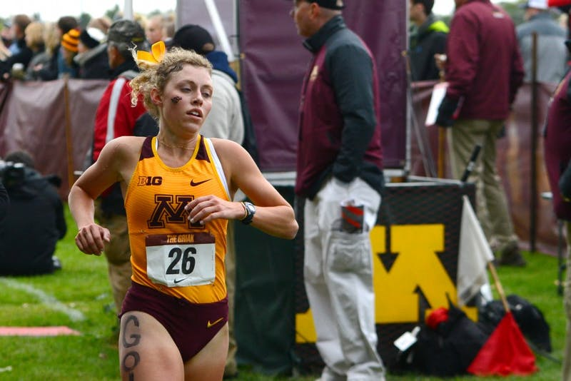 Molly Eastman crosses the finish line at the Roy Griak Invitational at Les Bolstad Golf Course on Saturday, Sept. 29.