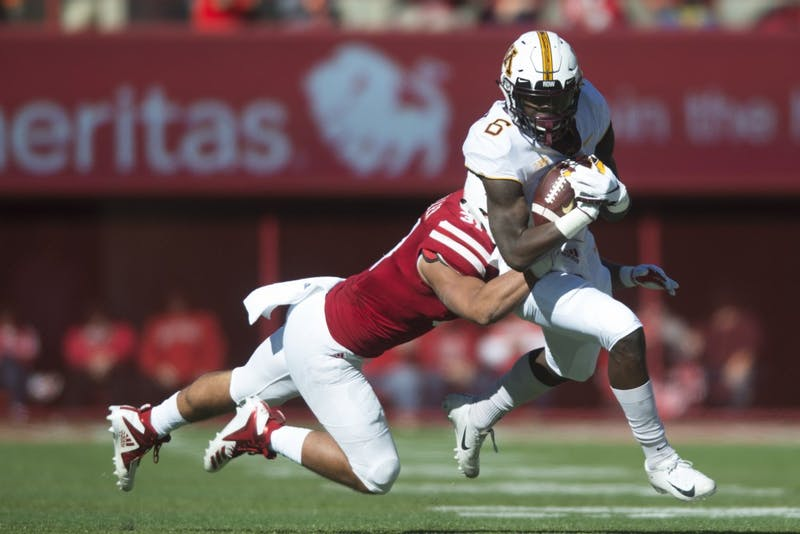 Wide receiver Tyler Johnson attempts to avoid being tackled on Saturday, Oct. 20 at Memorial Stadium. Nebraska defeated the Gophers with a final score of 53-28.