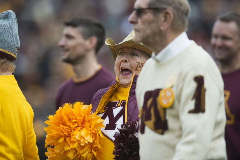 Alumni cheer on Saturday, Oct. 6 at TCF Bank Stadium. The Hawkeyes defeated the Gophers 48-31.